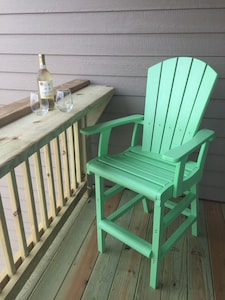Deck with bar and two pub chairs. Back deck with ocean view.