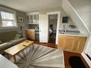 Living room showing kitchenette and door to bedroom