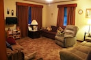 Living Rm. Sit, chat, watch TV. Left couch folds out. Right couch comfortable.