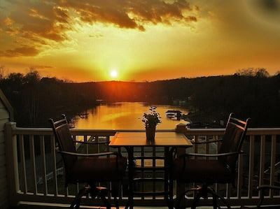 After a Great Day on the Lake, Relax have dinner while watching the Sun Set