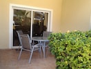 Patio Table, Chairs, Large Sun Umbrella, own Sunbeds