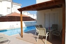 Pergolia and patio area by pool