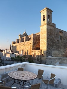 Dinner al fresco on the terrace right under the church tower.