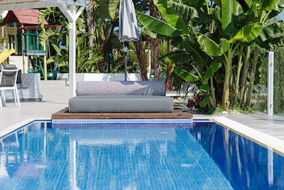 Sophisticated pool surroundings offering a sense of tranquility.