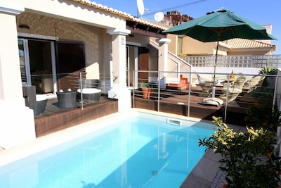 South-facing private pool with glass and steel protective barriers
