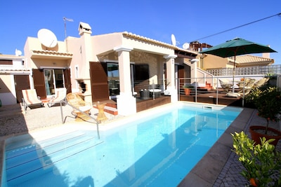 Super villa with private pool, loungers and dining table & chairs on the decking
