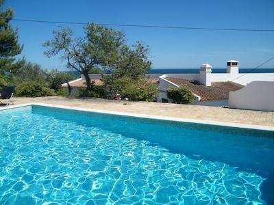 Private pool above the villa overlooking Meia Praia beach