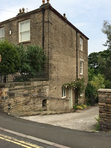 Spacious property attached to a large period home. Private parking to the rear.