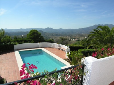The private pool with views across the Mijas hills