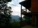 Side view of the home, and 2 decks overlooking the mountains