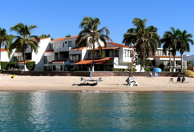 Beachfront view of 2 story condo in center of picture.