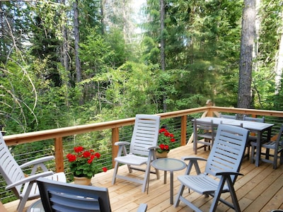 Sitting and dining areas on the large private deck overlooking the creek