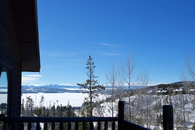 Mid-winter view of frozen Shadow Mtn Lake from deck