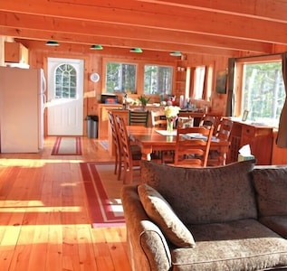 View of Kitchen and Dining room from the living room. The Bay is to the right.