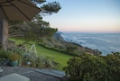 Patio steps to the lawn & cliff edge with South views of the coast