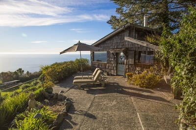 The stone path & patio that leads to The Gallery House on our Big Sur property