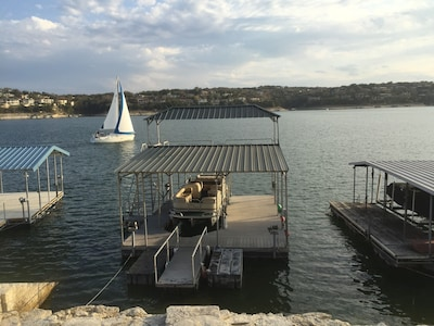 Outstanding view of Lake Travis and private boat dock (24X36) with upper deck.