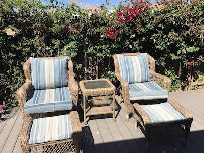 Relax in the sun on the deck while listening to the ocean waves.