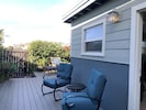 Side deck with rocking chairs and access to the living room