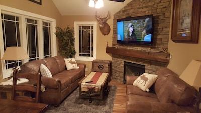 "Living Room, Gas Fireplace, Queen Sleeper Sofa, 65"" TV, WIFI"
