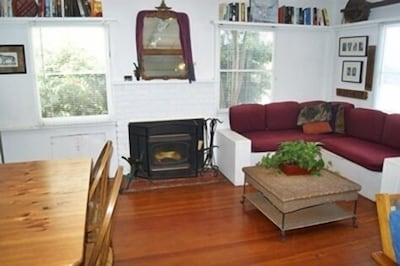 Living room with wood burning stove/fireplace