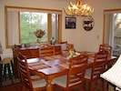 Dining Room (sits up to 10) with mountain view out the windows + bar stools