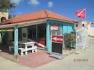 Full service dive center next door ; Buddy dive has all equipment rentals .
