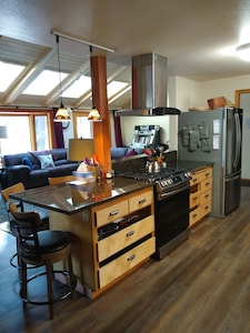 Kitchen open into living room, new gas range