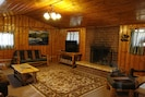 Spacious great room with TV, BluRay, fireplace. Love seat/chair convert to beds.