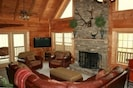 Living room with 20 foot vaulted beamed ceilings