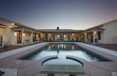 Serene interior courtyard with 38 ft. heated pool and spa.