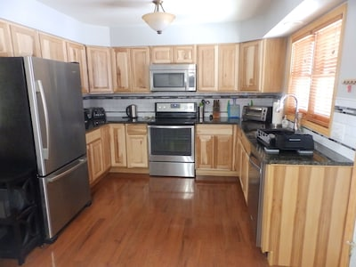 Kitchen is  well equipped to prepare big family meals, or  to grab a quick bite.