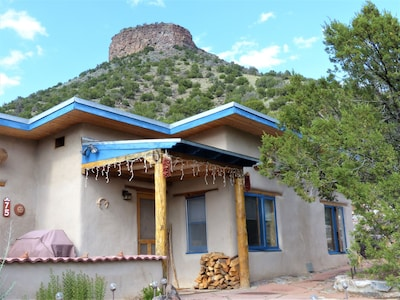 Traditional adobe casita. Hot tub, three patio areas. You can climb the mesa!