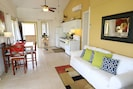 Spacious living room opens to the 50Ft. screened in porch!