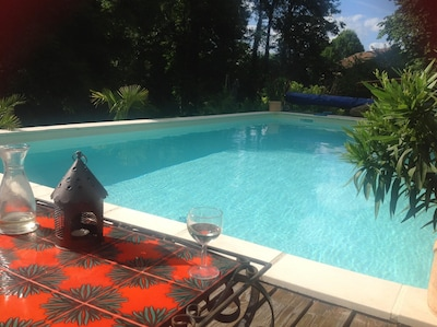 Large Pool in private landscaped garden and sun decking