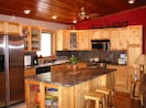 Updated Kitchen with all of the amenities including granite counters