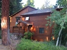 Front of our Charney Chalet at dusk on wooded underground utility street