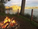 Gather around the fire pit by day or night to enjoy a spectacular lake view.