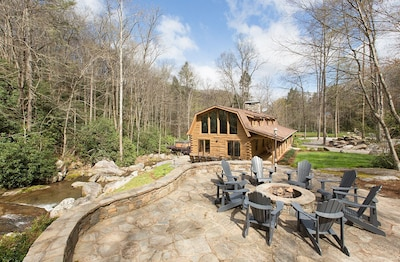 Fire Pit Stone Patio Overlooks the Main Cabin and Hot Tub Deck