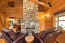 Enjoy a book in front of the gas fireplace on super comfy leather recliners