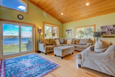 Bright, cozy living room with a view of Erie Lake.