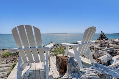 Soak up the sun and views from our deck chairs perched alongside the dritftwood!