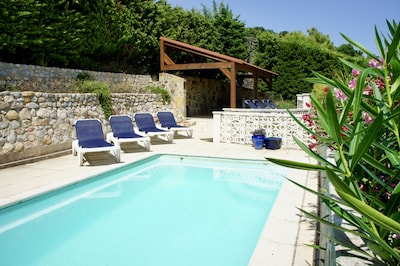 Heated swimming pool area, pergola with fridge