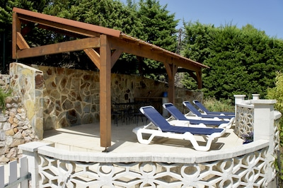 Pergola on upper swimming pool terrace