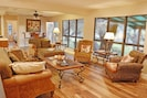 Comfy living area with fantastic views of the lake and yard area
