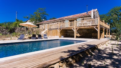 11x5m pool with large travertine bathing area, oak terrace and converted barn.