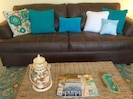 Beautiful coastal design throughout with new leather queen sleeper in den.