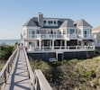 rear of house with private walkway to beach; bay across dune road on other side