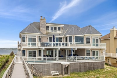 rear of house from private beach walkway, highlighting your 3 floors of decks