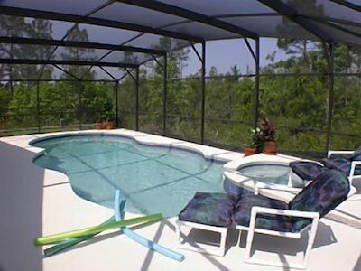 Extended deck with large pool & spa. Woodland view